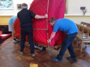 Piano being moved into its place