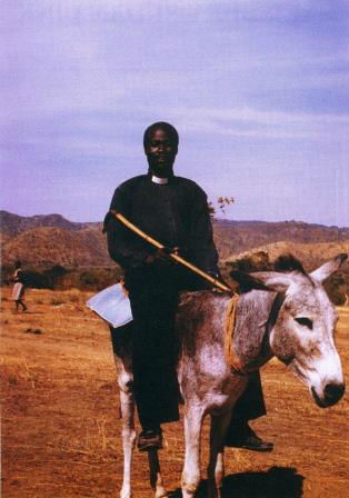 pastor on donkey