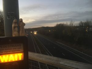 Mary and jospeh figures on top of a wait signal crossing the A2