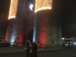 Mary and Joseph figures by west gate towers at night