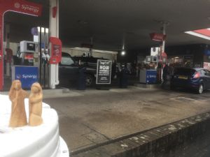 Mary and Joseph figures next to a petrol station