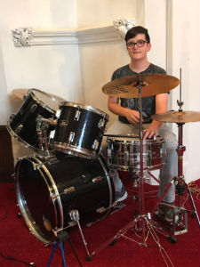 Callum playing drums