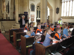 children at experience easter in pews