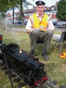 Church warden Gerry Devine with steam train