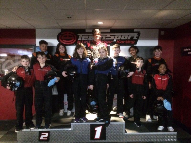 go-karting group on the podium