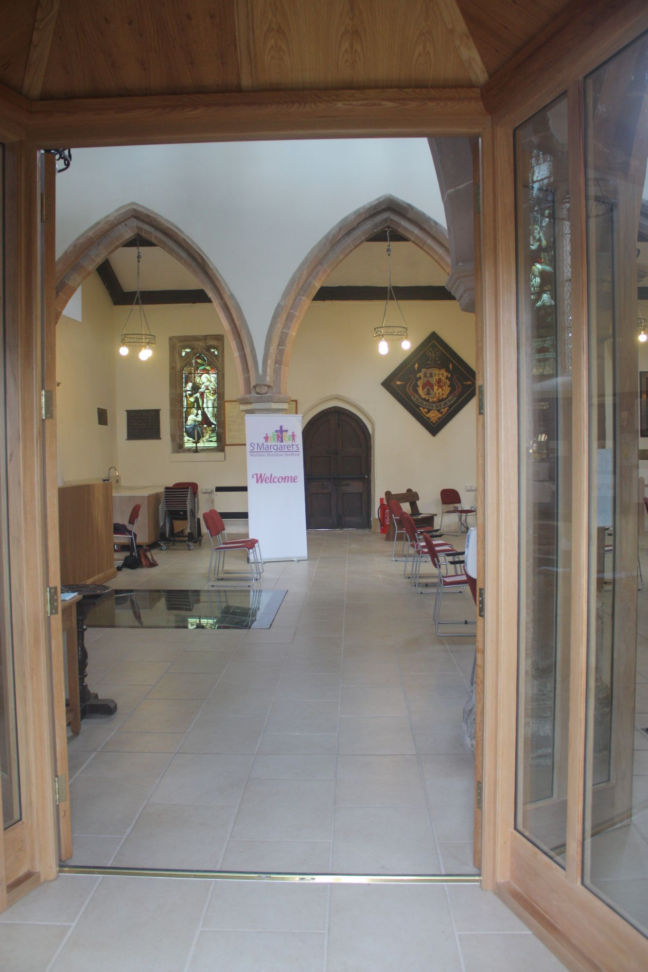 A photograph showing a view from inside the door, showing the porch.
