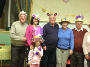 Adults and children in Easter bonnets