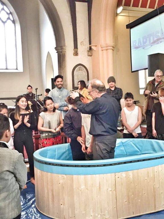 one of the youth being baptised