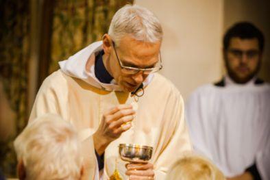 Revd Mitch giving communion