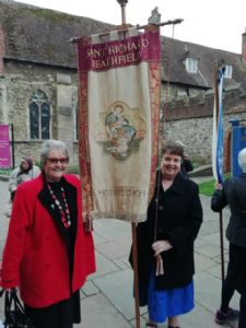 Heather and Mary from St Richards' Mothers Union holding flag