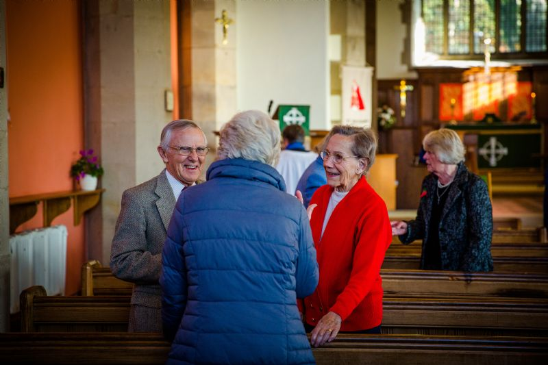 People talking in St Richard's after a service