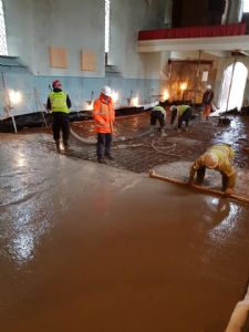 Pouring and flattening the concrete