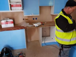 Kitchen units in (with protective film - they are not blue)