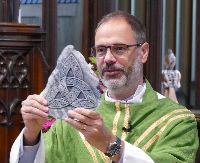 Picture of James holding celtic knot symbol of the Trinity