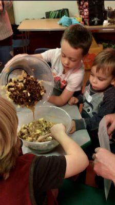 Children mix their ingredients