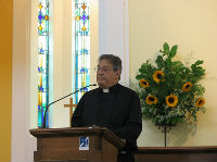The minister, Rev Graham Dadd, at the lectern during service