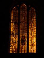 Coronation window by candlelight