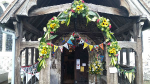 entrance to church with sunflower arch