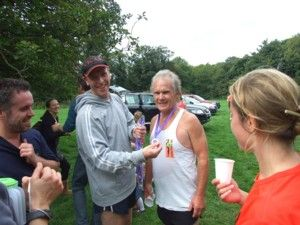 Michael handing out the Childrens Society finishers medals