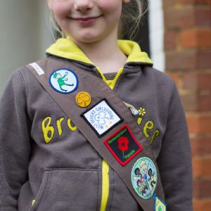 girl with Brownie Badges