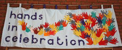 hands in celebration banner