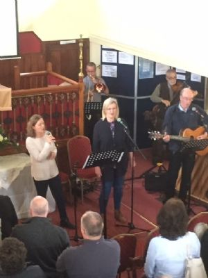 The musicians leading worship
