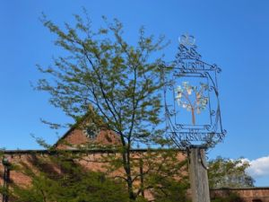 Blue sky over the Hall and the Perifrith sign