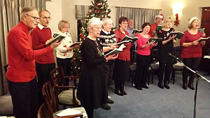 Choir singing carols in a local retirement home
