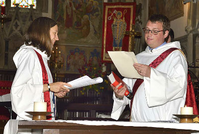 Phil Price reading his licence to the congregation
