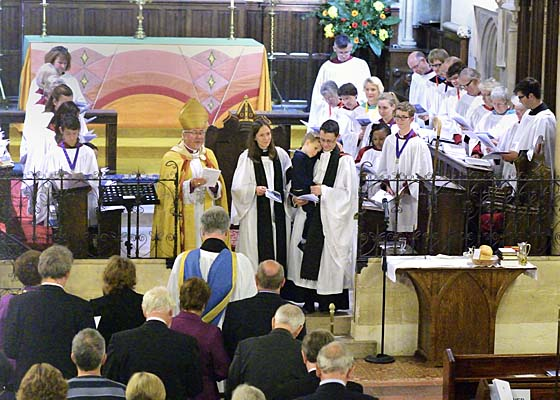 The Bishop presents Philip and Hannah to the people