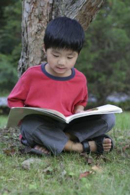 Boy reading activity book