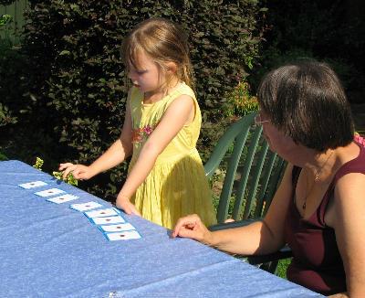 Grandmother and grandaughter play Bible games