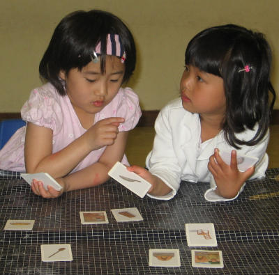young Christian South Korean girls play Bible games