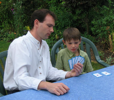 Christian father and son play Bible activities