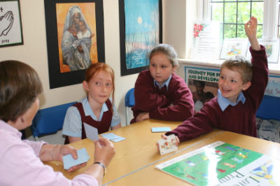 children play christian card games at school