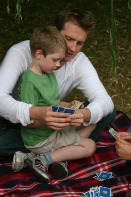 Christian Father and son play Bible games