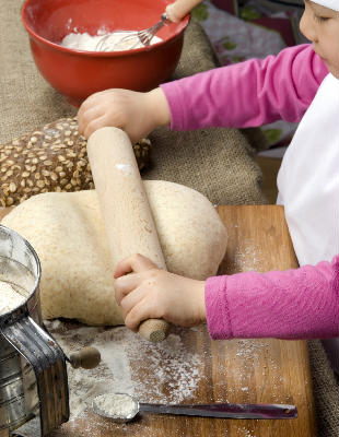 girl rolling dough mustard seed games activity