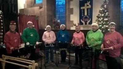 Steel pan drummers in their new sweatshirts