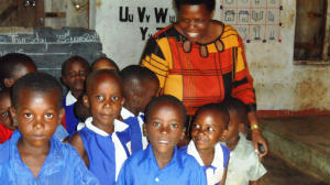 School Luweero headmistress with pupils