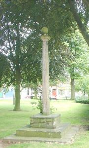 Ancient preaching cross outside All Saints