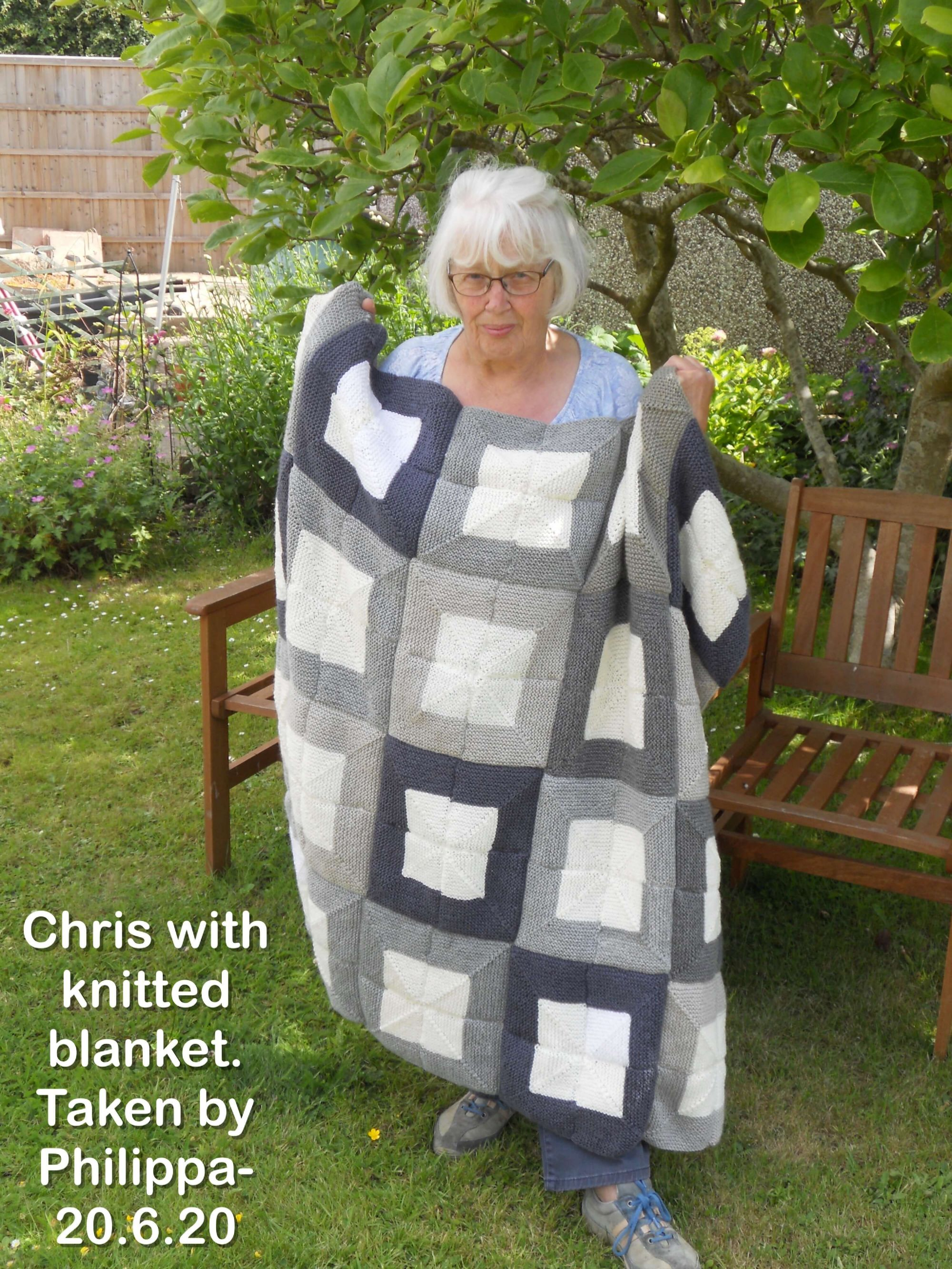 Chris with knitted blanket.