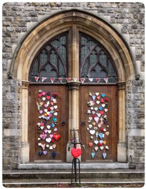 Church door decorated with hearts