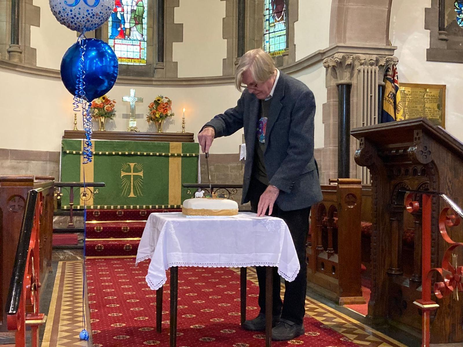 Derek cutting his cake