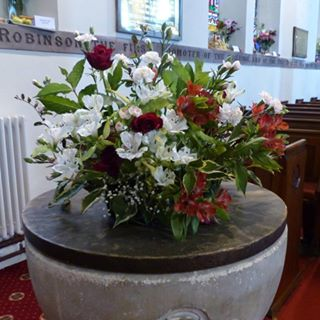 Font in its new location at the front of church