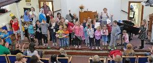 Children showing handicraft Christmas Messy church