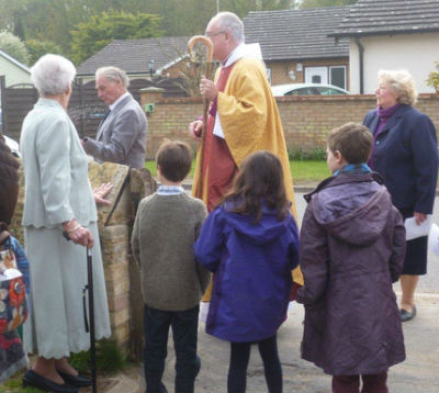 Bishop blessing the wall