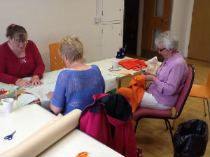 Ladies cutting out bunting