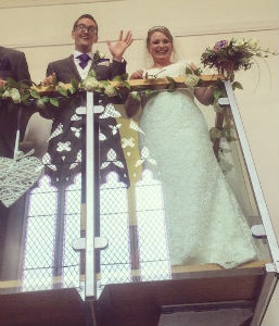 Bride and Groom waving from the balcony