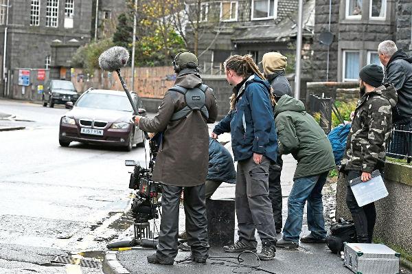 Filming in street