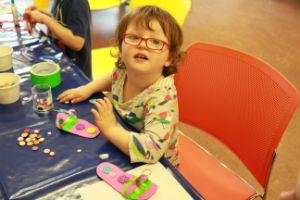 Child making flip-flops